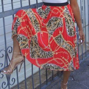 pleated skirt chain x cheetah print